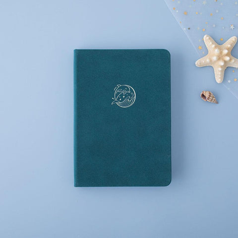 Tsuki sea green velvet Dolphin Days notebook with starfish on blue background