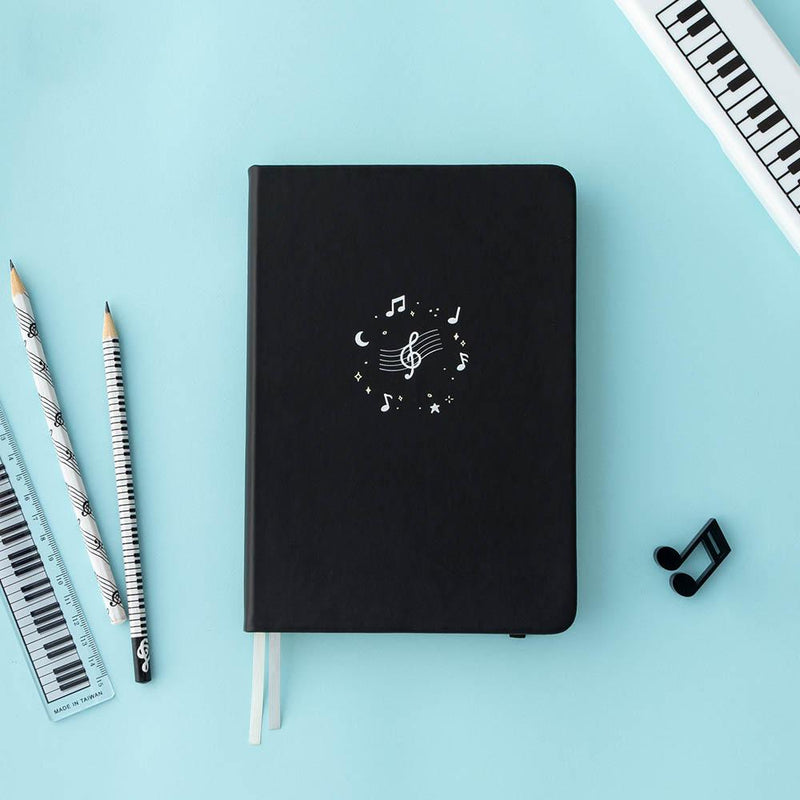 Tsuki Lunar Notes bullet journal with stationary flat lay image on blue background
