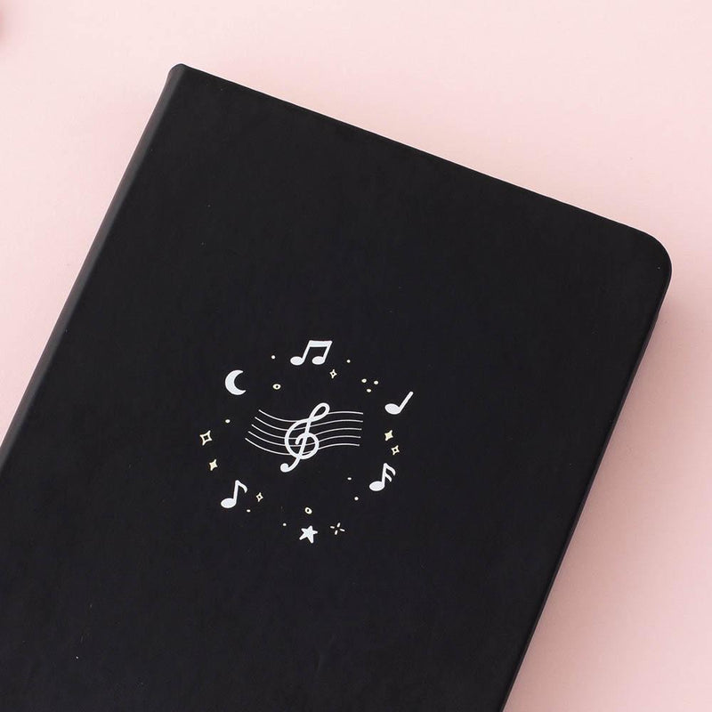 Close up of Tsuki Lunar Notes bullet journal front cover design image on pink background