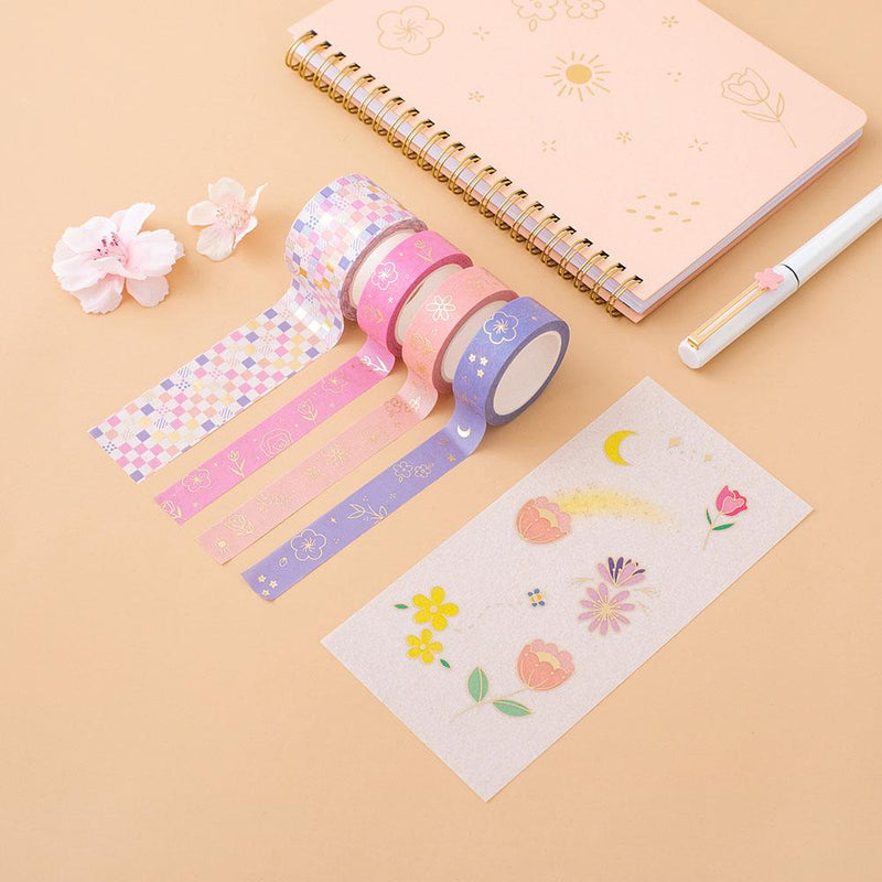 Tsuki Floral washi tapes rolled out with sticker sheet and honey peach ringbound bujo on peach surface