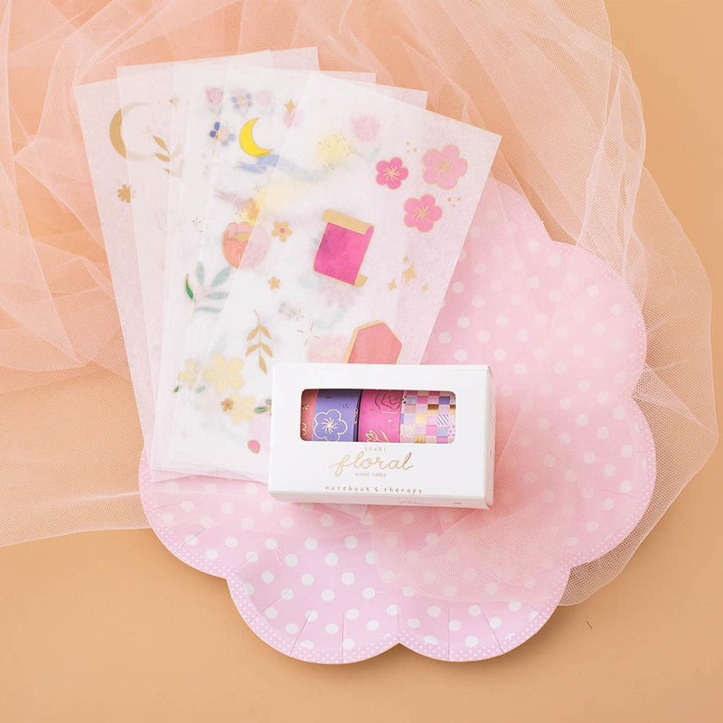 Tsuki Floral collection, washi tapes in boxed packaging and 6 sticker sheet laid out on peach background