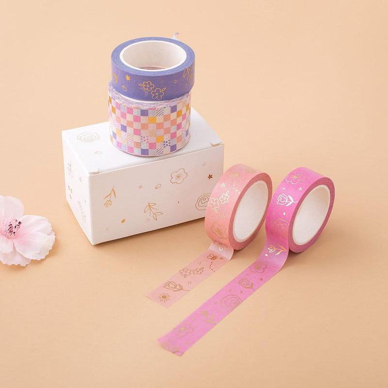Tsuki Floral washi tapes laid on peach background with boxed packaging