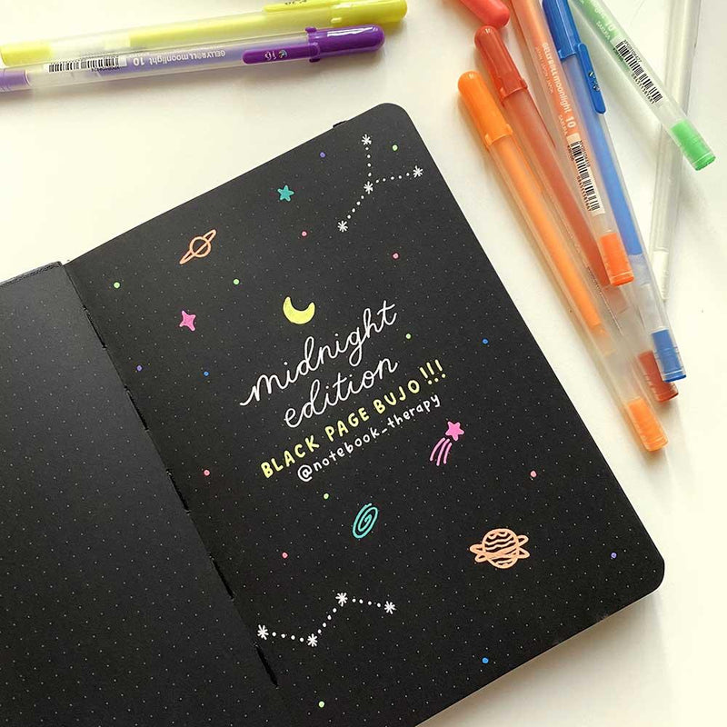 galaxy doodles on black page bullet journal using gelly roll moonlight set