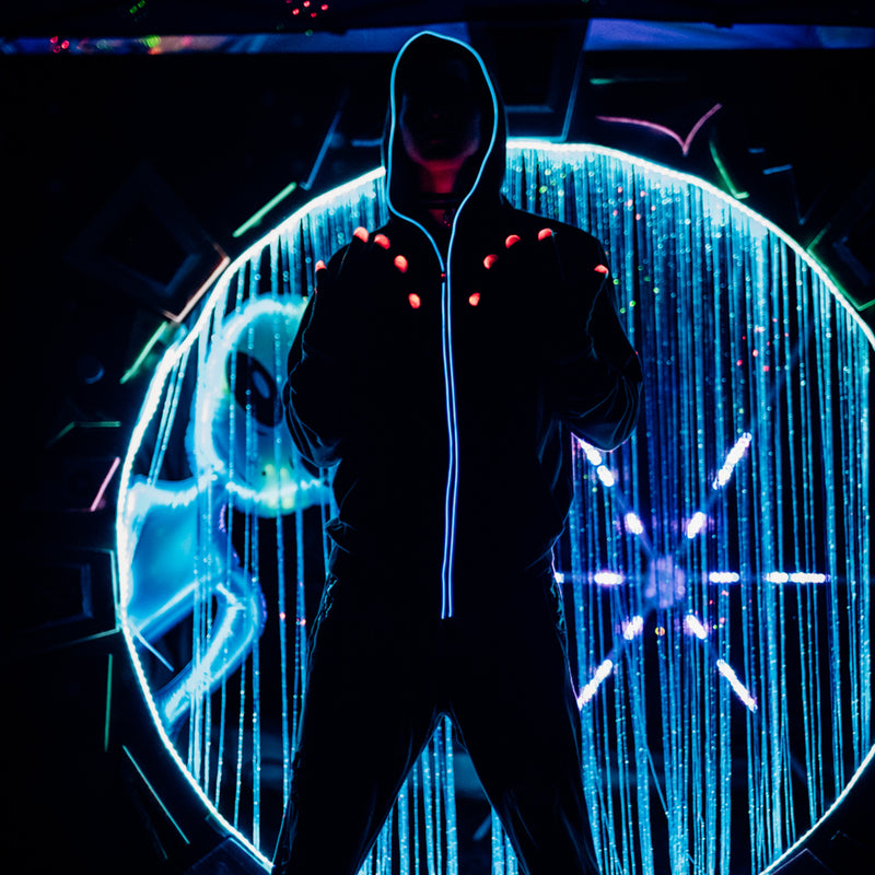 Snug: Lumio Designs light up glowing black hoodie with EL Wire