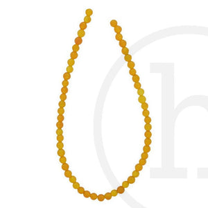 Dyed Orange Jade RoundBeads by Halcraft Collection