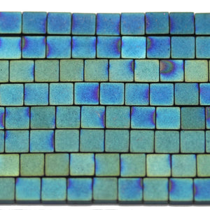 Matt Aqua Iris Coated Hematine Square (2-Hole) 4mm  - 16 inchesBeads by Halcraft Collection