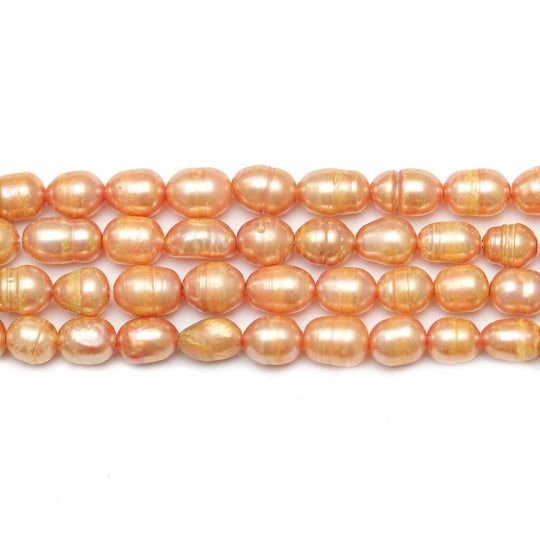 Peach Dyed Fresh Water Pearls Rice (Hole Through Width) Sizes VaryBeads by Halcraft Collection