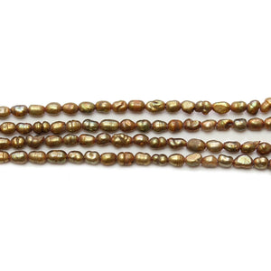 Amber Dyed Fresh Water Pearl Rice Beads (Through Drilled Oval) Sizes Vary