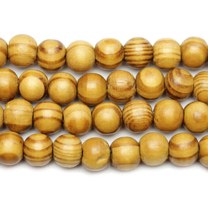 Philippine Polished Olive Wood Natural Tan 10mm Round BeadsBeads by Halcraft Collection