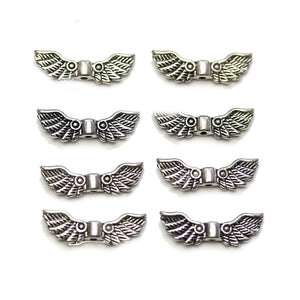 Silver Plated Round Metal Wing 7x21mm BeadsBeads by Halcraft Collection