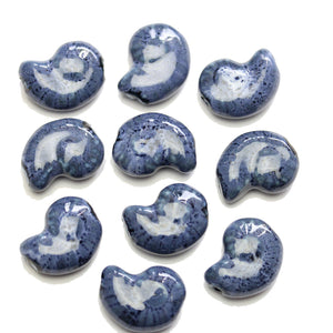 Blue Glaze on White Ceramic Conch 15x20mm BeadsBeads by Halcraft Collection
