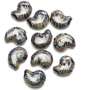 Purple & Brown Glaze on White Ceramic Conch 15x20mm BeadsBeads by Halcraft Collection