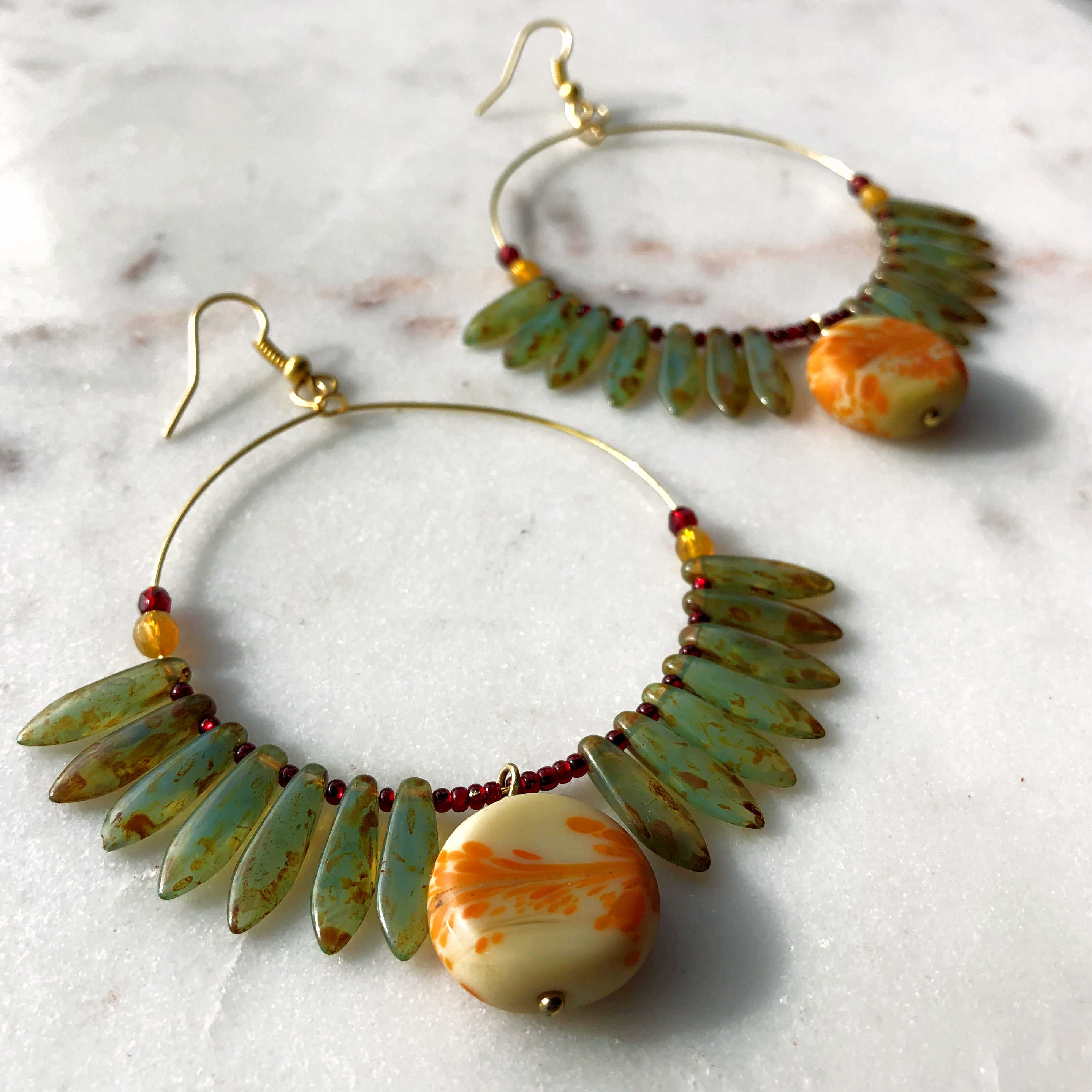 fringe earrings with green and orange beads