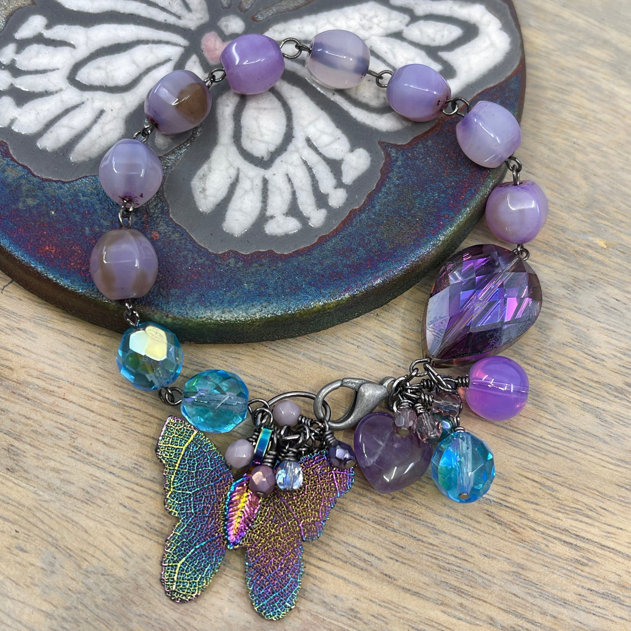 colorful glass and stone bead bracelet with butterfly pendant