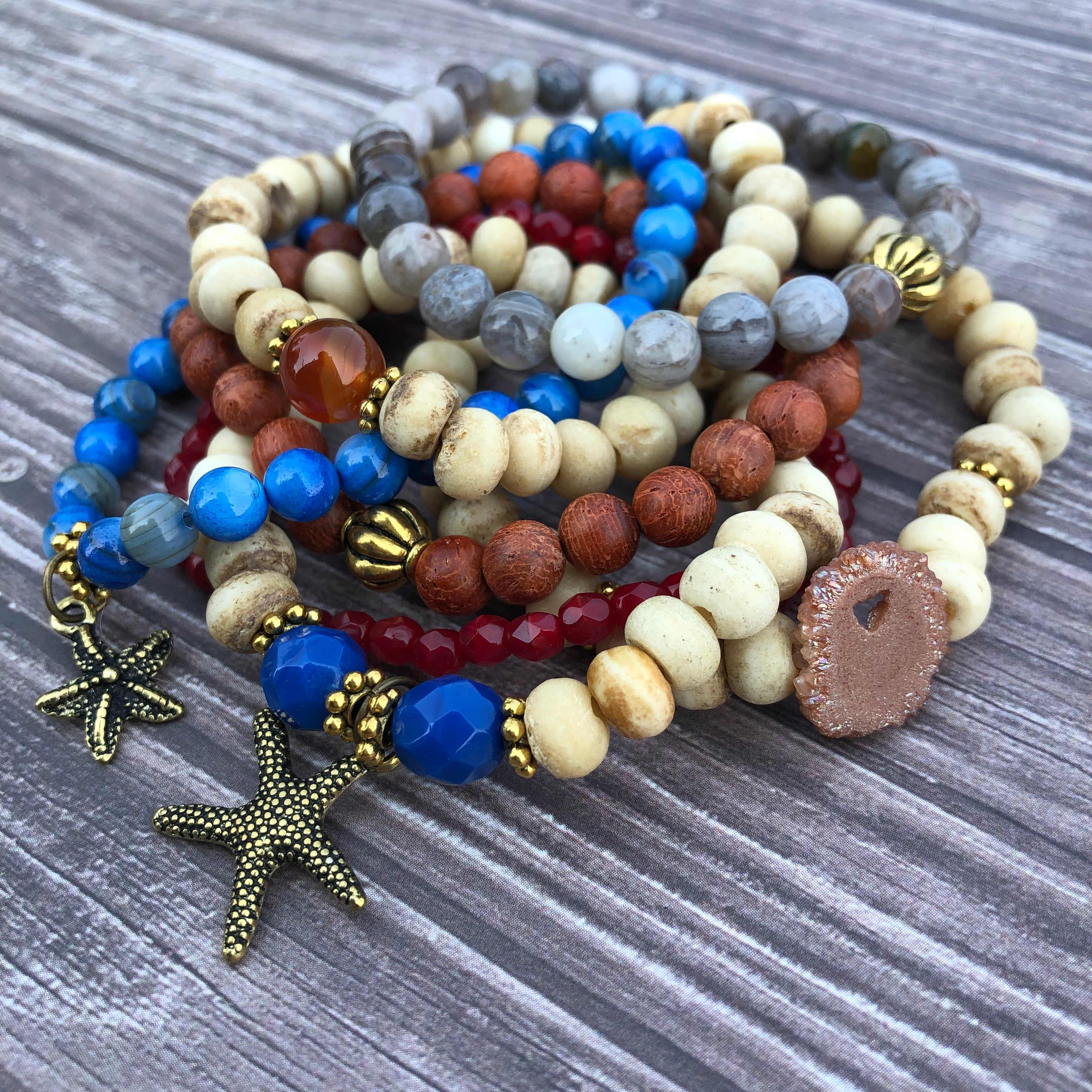 Wood, shell, and stone bracelet stack with starfish charms