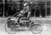 Henry Ford sitting in his quadracycle.