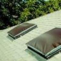 Square dome skylights with brown exterior solar shades.