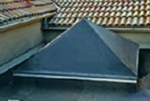 Pyramid skylight with Fisher exterior solar light gray shade.