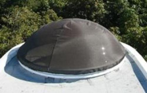 Round dome with dark brown skylight shade.