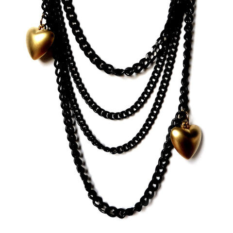 Light weight black quin chain necklace made with almanite with two matte-finish gold heart charms. Close-up image. ync by nny. Yn Couture by Nana N Yoshida.