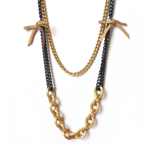 Light weight double chain long necklace. Black and matte gold metal. Beige suede bows. 27 to 31 inches. Gothic and New Romantics. Designed by Yn Couture by Nana N Yoshida. Ync by nny