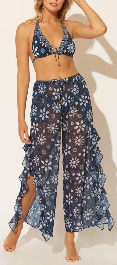 Flat front silhouette Wide leg Ruffle side slits Batik print Lined Straight hem Pull-on construction Polyester Hand wash Product Number: RBDP20849