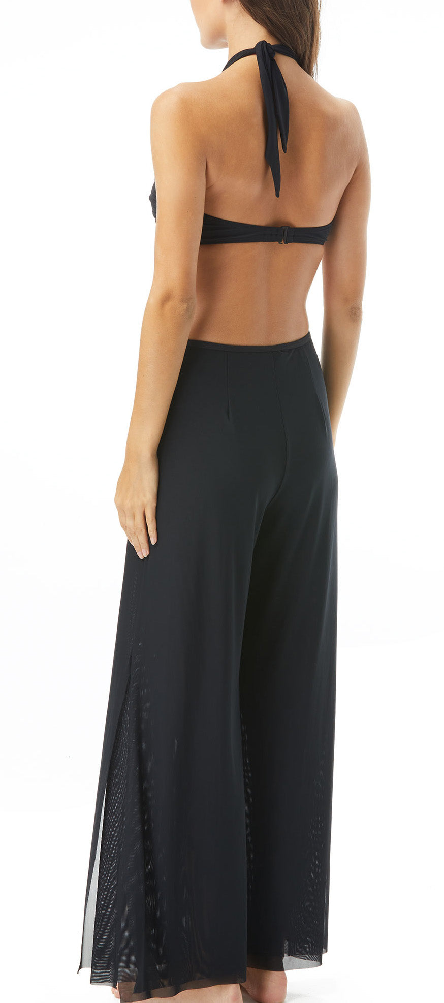 Elegant and effortless, the Carmen Marc Valvo Double Layer Wide Leg Mesh Cover Up Pants are perfect for day-to-night styling. The mid rise, easy fitting sheer pant features breathable mesh to keep you cool, an elastic waistband, and side slits creating a must-have resort-ready cover up.     Cover Up Pants Double Layered Mesh Wide Leg Fit Elastic Waistband Side Slits Hand wash cold, line dry Mesh Fabric: 94% Nylon/ 6% Spandex  Product Number: C1C891