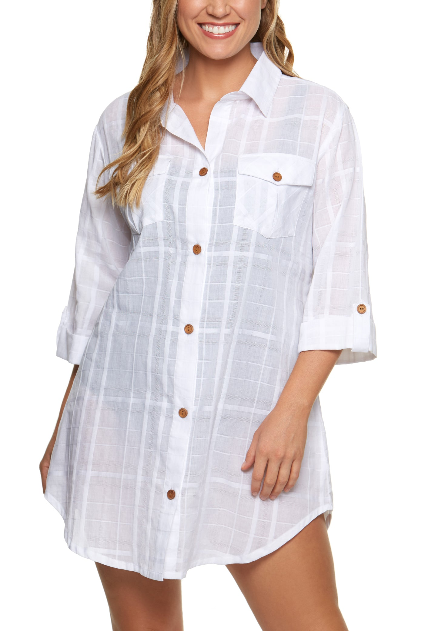 Knee length Button-front closures; point collar Double button flap patch pockets; Tiger's eye buttons; shirttail hem 3/4-sleeves with buttoned cuffs Rayon Machine washable Product Number: 11132