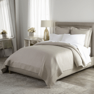 platinum Angelina coverlet and shams with white sheets on bed