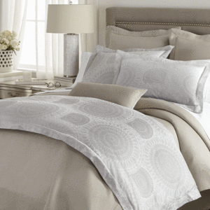 Elise duvet cover and shams styled with linen colored bedding