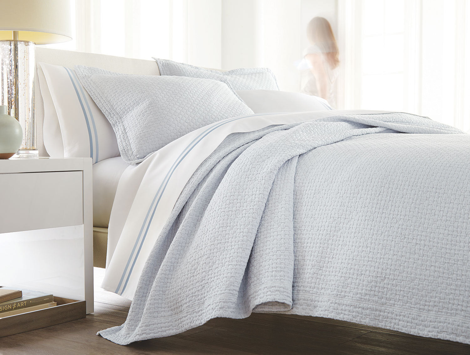 Barely Blue Juliet coverlet on bed with Duo striped sheets