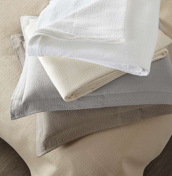 stack of folded Montauk shams in various colors