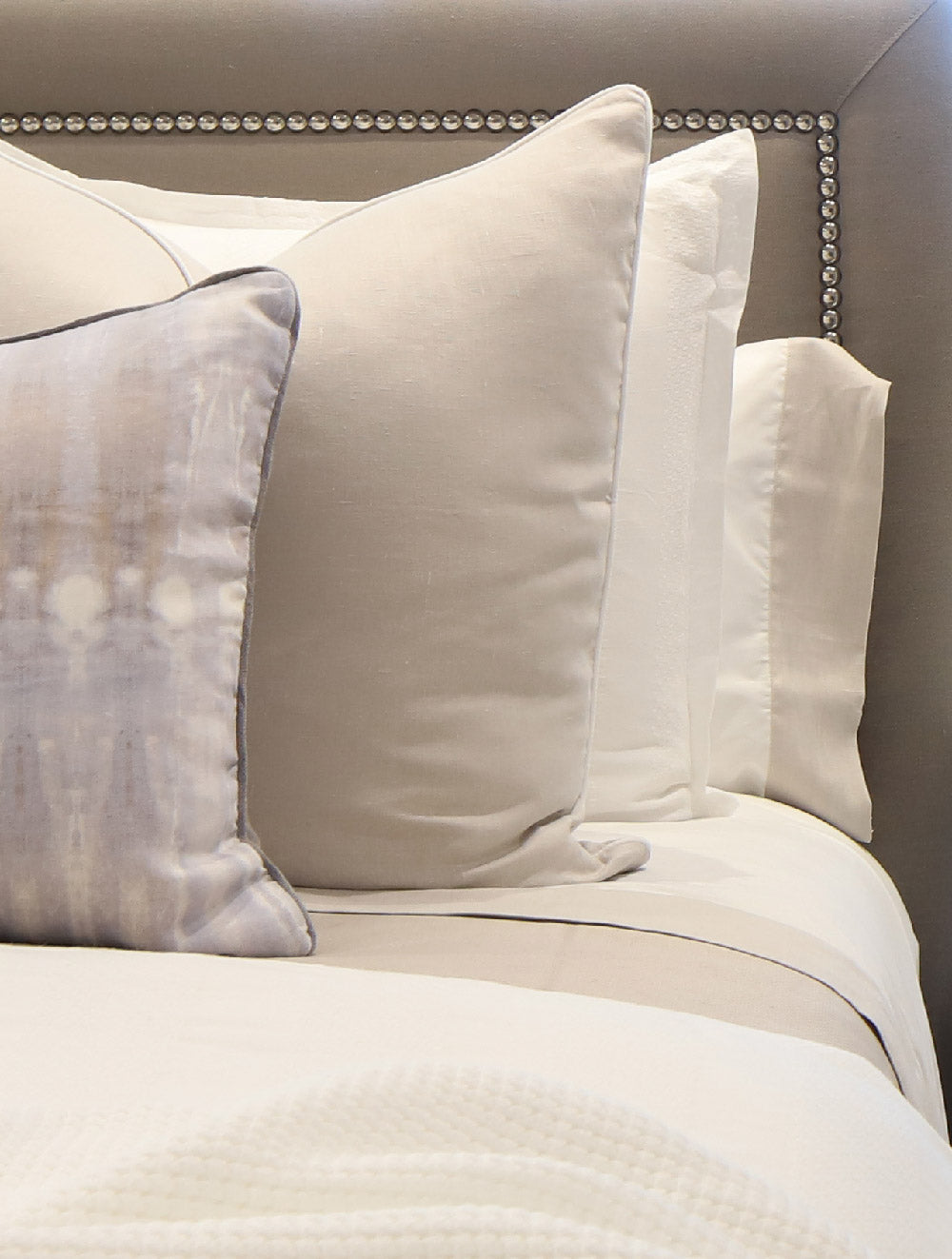 Decorative pillows combined with our Mandalay Cuff Sheet Set and Mandalay linen shams
