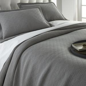 pewter Paulo coverlet and shams with white sheets on bed