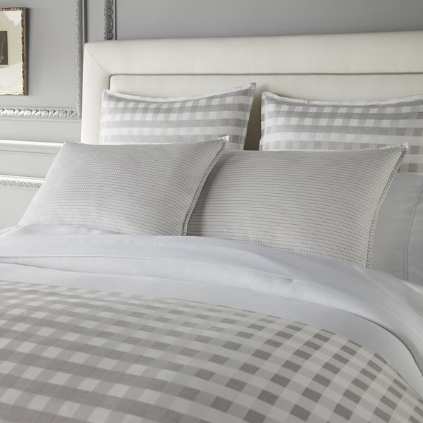 white and grey Prescott shams and duvet cover styled on bed
