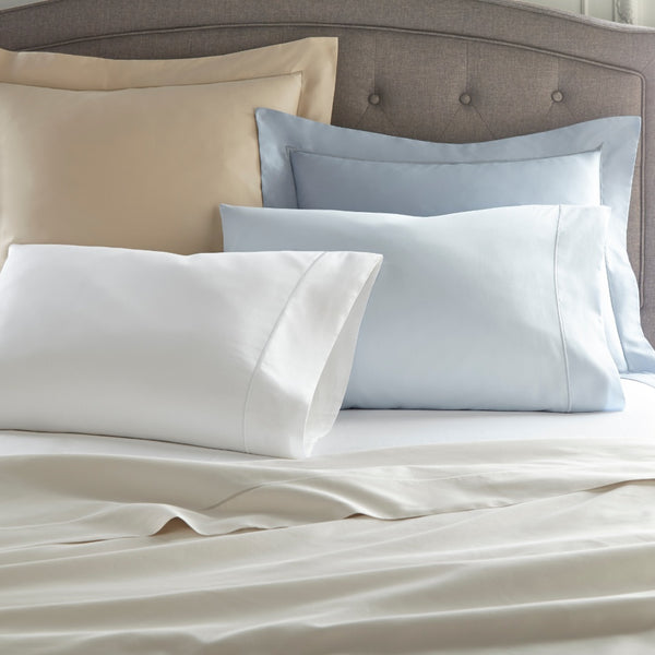 soprano shams pillow cases and sheets in various colors on bed