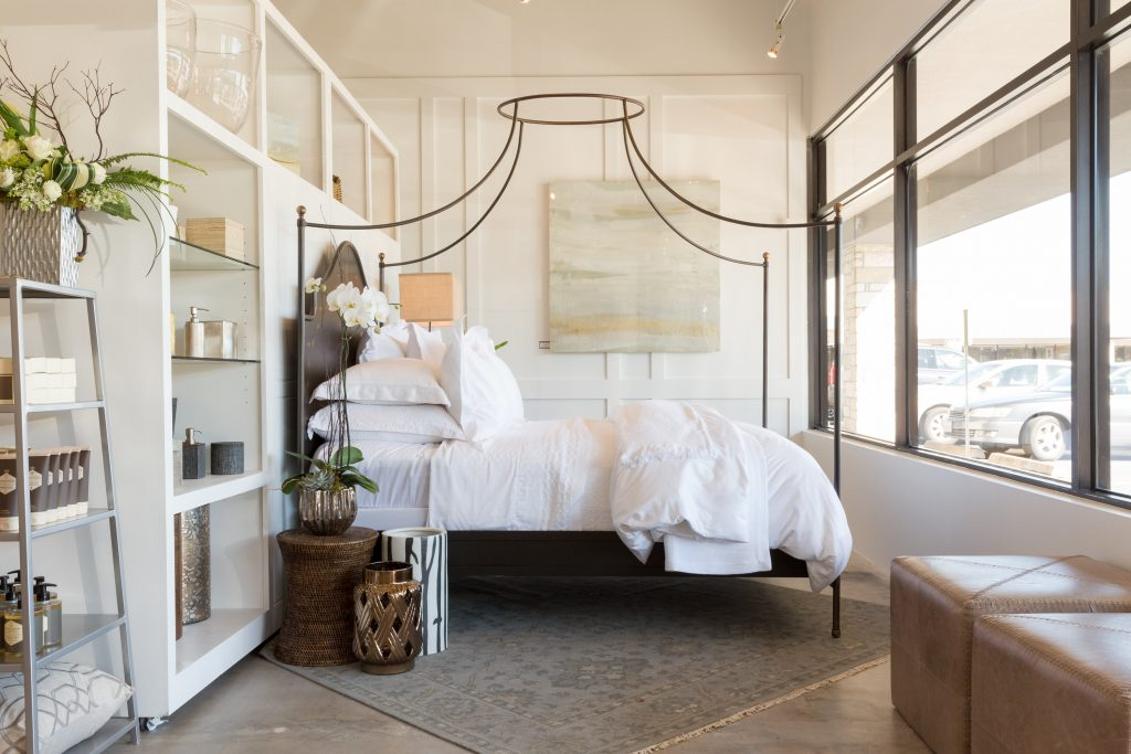 All white tailored bed with a canopy in a store
