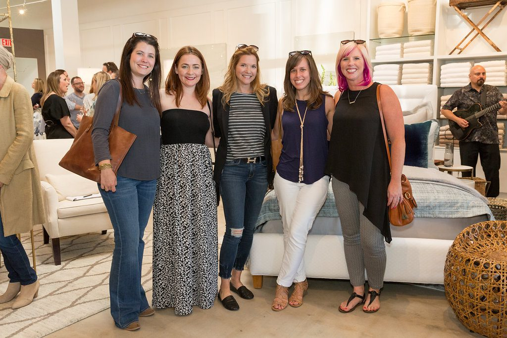 A group of women pose at the opening of the new Peacock Alley store in Austin, TX