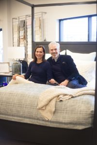 Mara Miller & Jesse Carrier posing with their bedding design