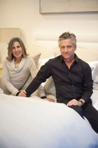 Brooke & Steve Giannetti posing with their bedding design