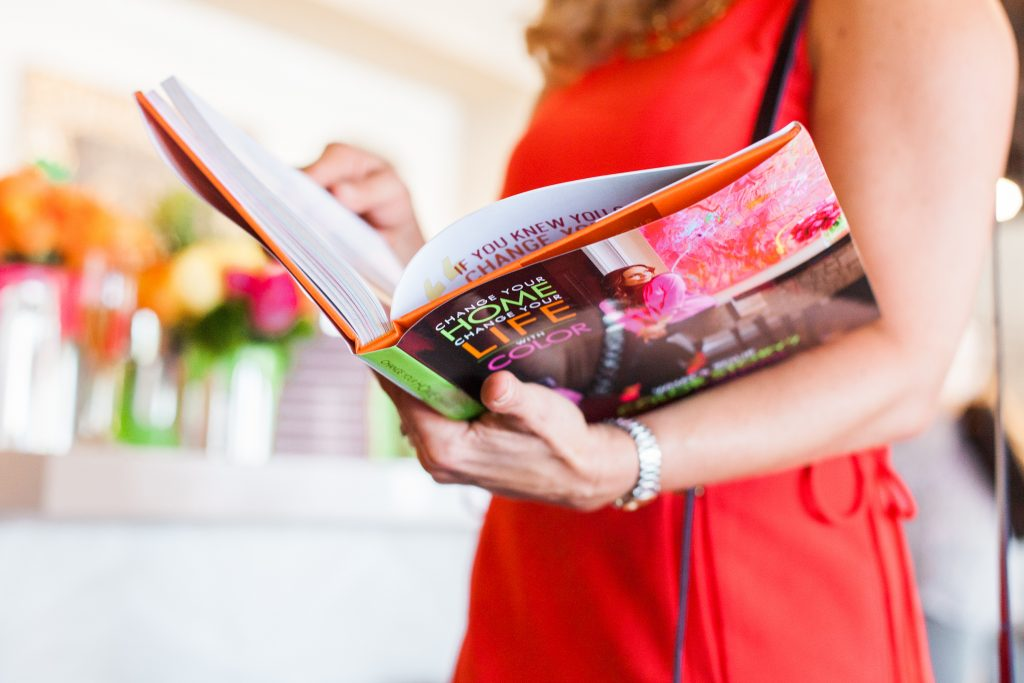 Woman reading a book: Change your Home, Change Your Life with COLOR!