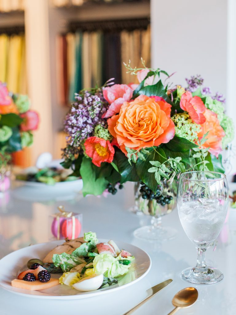 Luncheon place setting with colorful flower bouquet