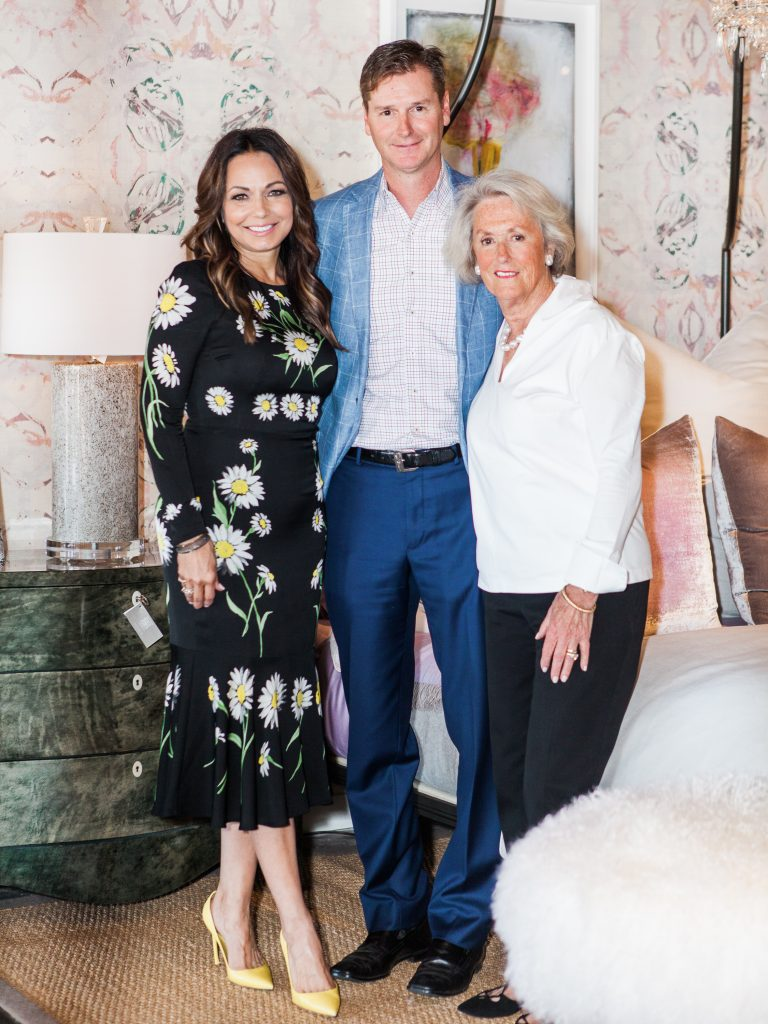 Moll Anderson with Jason Needleman and Mary Ella Gabler in front of a bedding display