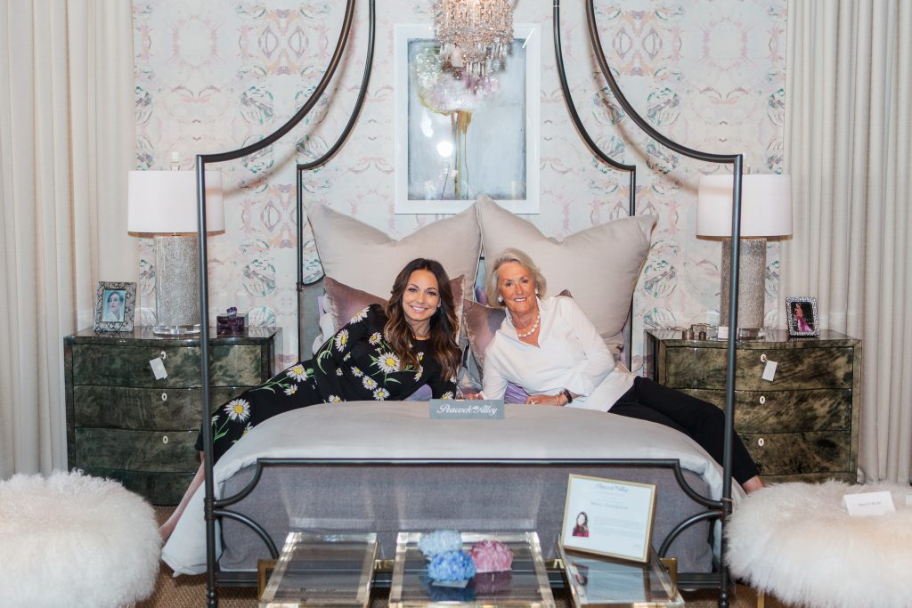 Moll Anderson and Mary Ella Gabler posing on a canopy bed