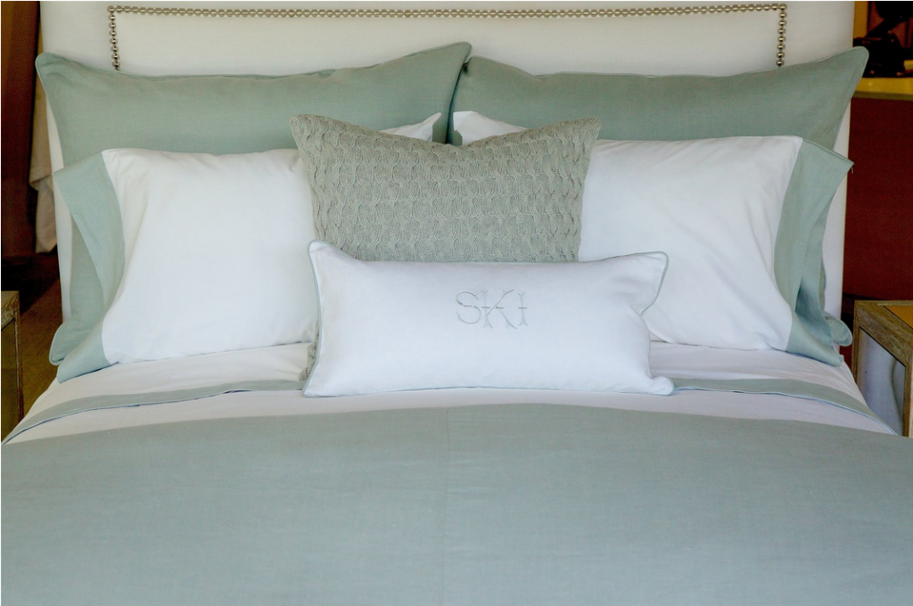 Suzanne Kasler's bedding design featuring a mist and white motif with textural accents