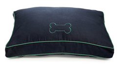 A navy dog bed with bright green trim