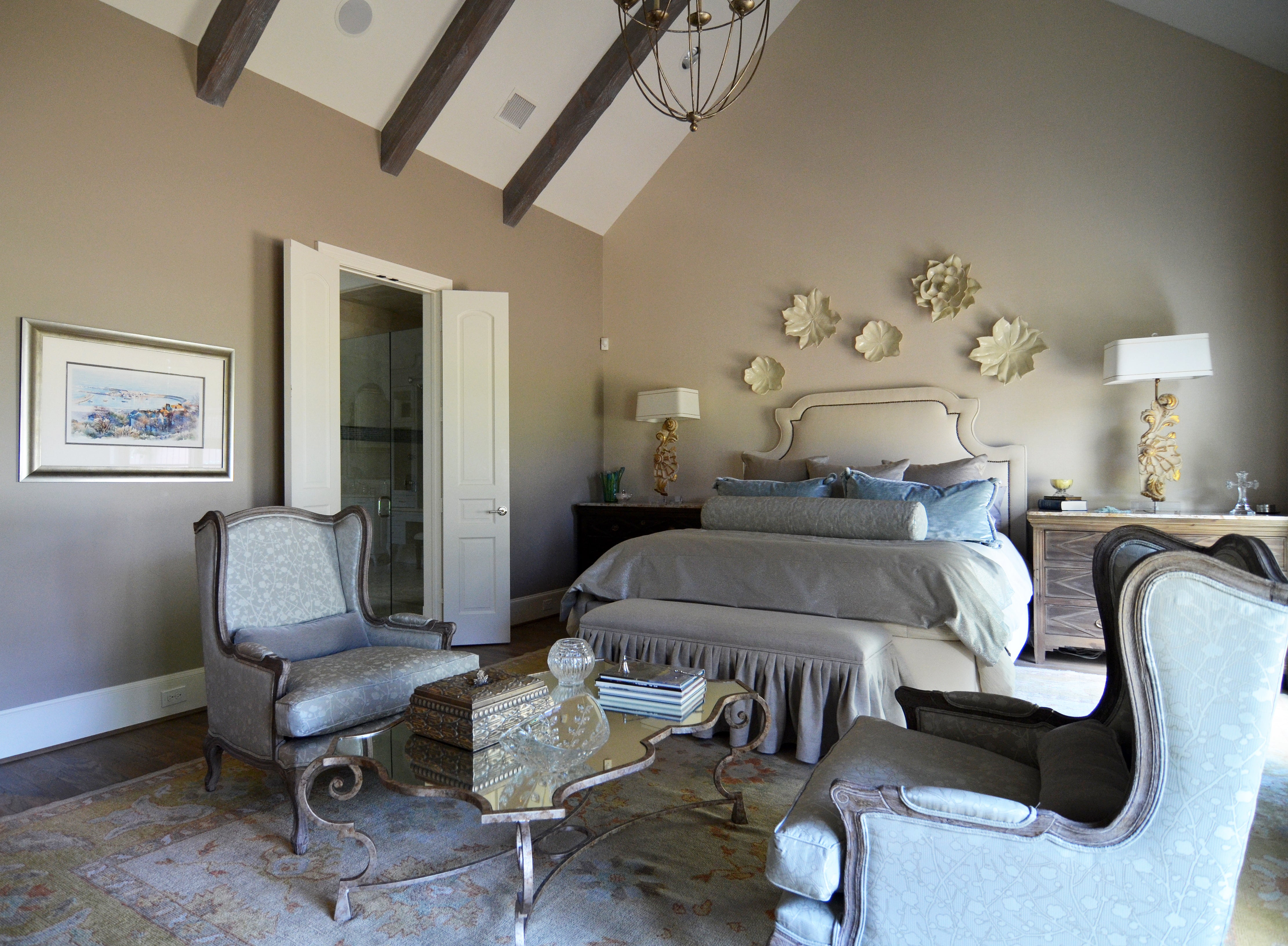 Classicly decorated bedroom with accents of pale blue and gold