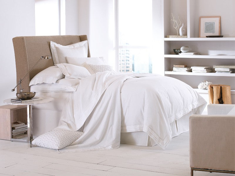 All white bedding with textural elements for added depth