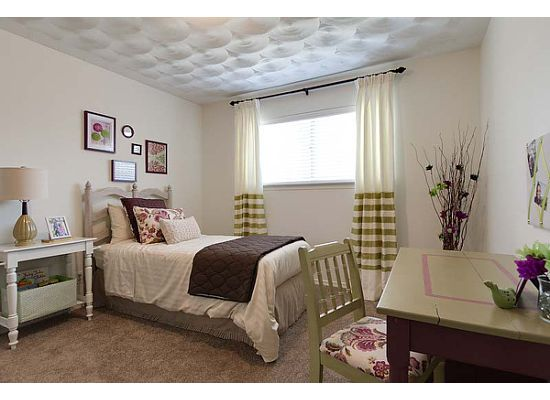 Girl's room  decorated in a spring motif of apple green, rose and white.