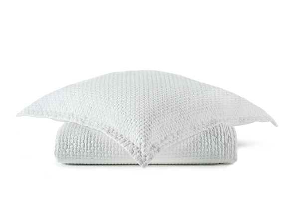 All white matelassé coverlet and sham in a pebble design